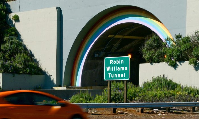 A sign stands at the northbound entrance to the recently renamed Robin Williams Tunnel in Sausalito, Calif., on March 1, 2016. (Alan Dep/Marin Independent Journal via AP)