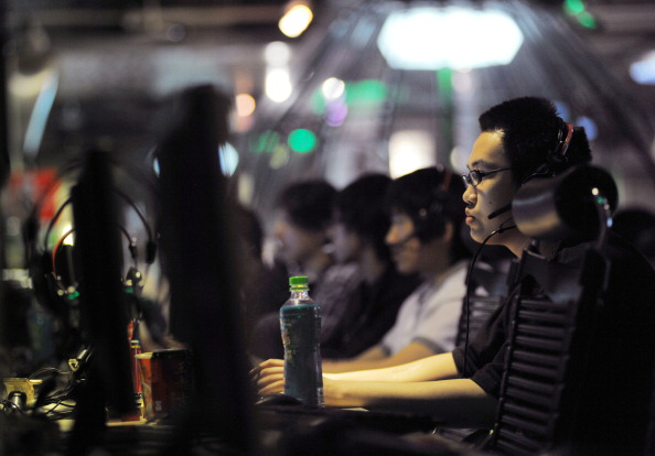 People at an Internet cafe in Beijing on May 12, 2011. Chinese netizens say the most recent online survey does not represent them. (Gou Yige/AFP/Getty Images)