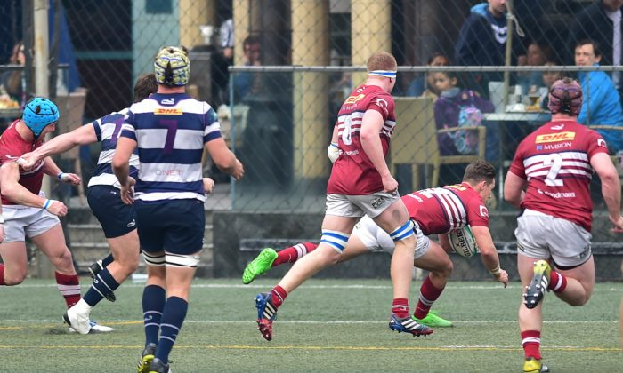 Richard Lankshear goes over for Sabre Kowloon's second try of the match, also converted by Lankshear to give the visitor a 12-5 lead at half time in the HKRU Grand Championship Quarter Final against Natixis HKFC on Saturday Feb 27, 2016. In a nailbiting finish the Kowloon defence held out to win 18-12 to move them into the Semi-final against Leighton Asia HKCC this coming Saturday. (Bill Cox/Epoch Times)