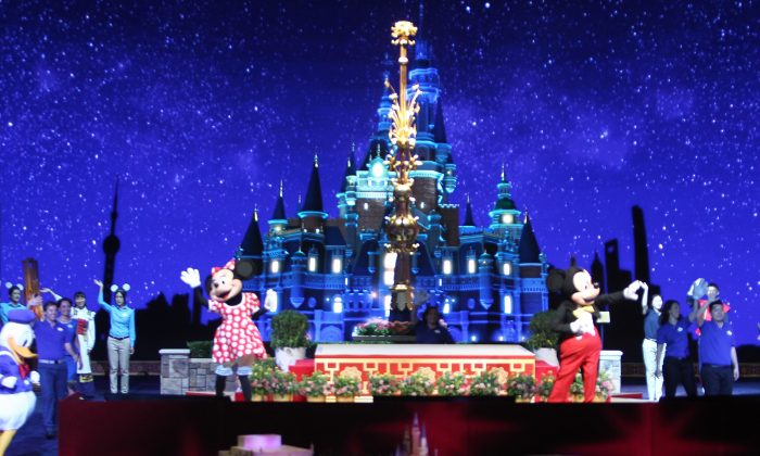 Two people dressed as Mickey and Minnie Mouse during the unveiling ceremony of six themed parks of Shanghai Disney Resort on July 15, 2015. One Chinese officials says children avoid Disney. (China Photo Press/Getty Images)