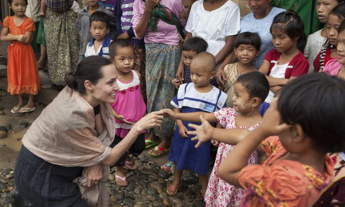 Angelina Jolie Pitt meets children during a visit to Ja Mai Kaung Baptist refugee camp in Myitkyina, Burma, on July 30, 2015. (Tom Stoddart/Getty Images Reportage/Maddox Jolie-Pitt Foundation via Getty Images)