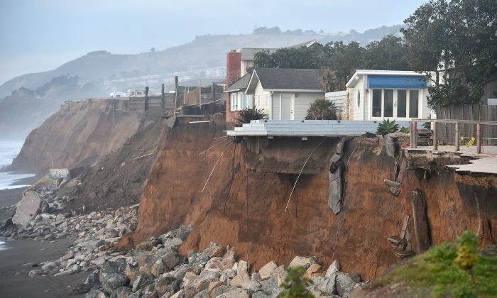 Sections of land are seen missing from coastal properties in Pacifica, California on January 26, 2016. (JOSH EDELSON/AFP/Getty Images)
