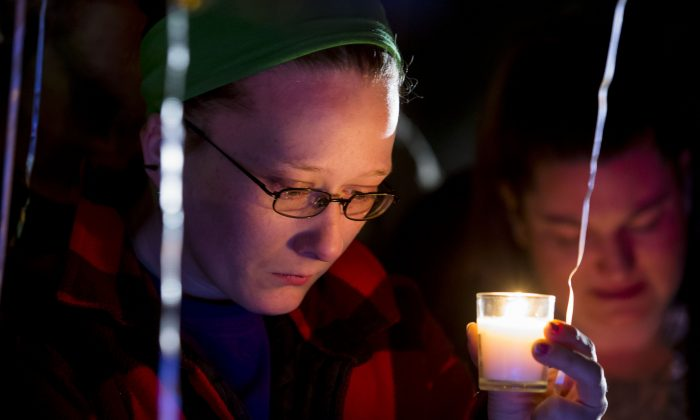 Family and friends hold a candle light vigil on Hesston Road for shooting victim Brian Sadowsky outside the Excel Industries plant in Hesston, Kansas, on Feb. 26, 2015. A gunman killed three people and wounded at least 14 on Feb. 25, 2016. The shooter was killed by police. (Kyle Rivas/Getty Images)