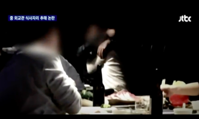 Censored screenshot from video taken at the scene of the drunken dinner. (via JTBC)