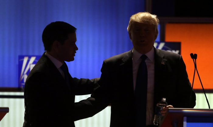 Republican presidential candidates Sen. Marco Rubio and businessman Donald Trump during a commercial break at a Republican presidential primary debate at Fox Theatre in Detroit on March 3, 2016. (AP Photo/Carlos Osorio)