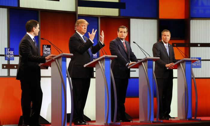 Republican presidential candidate, Donald Trump, second from left, gestures as Sen. Marco Rubio, R-Fla., Sen. Ted Cruz, R-Texas, and Ohio Gov. John Kasich watch him a Republican presidential primary debate at Fox Theatre on March 3, 2016, in Detroit. (AP Photo/Paul Sancya)