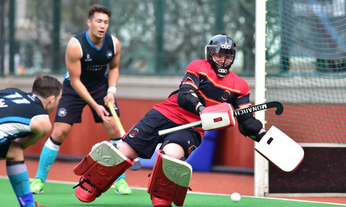 Gus Allan of HKFC-A scores against HKCC-A in the Premier division match at HKFC on Sunday Feb 28. HKFC went on to win a close contest 5-3 to retain their 2nd place in the standings behind Khalsa-A. (Bill Cox/Epoch Times)