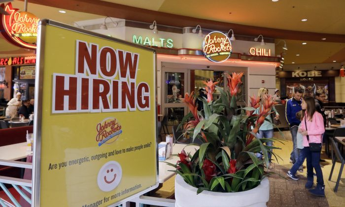 A restaurant posts a sign indicating they are hiring in Miami on Feb. 9, 2016. (AP Photo/Alan Diaz)
