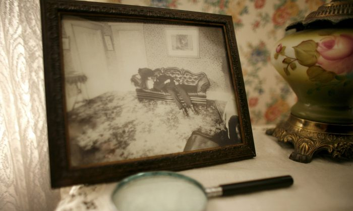 A crime scene photograph of Lizzie Borden's father Andrew Borden appears in the room of the former family home where he was killed in the infamous 1892 double murder, in Fall River, Mass., Wednesday, Aug. 20, 2008. (AP Photo/Steven Senne)
