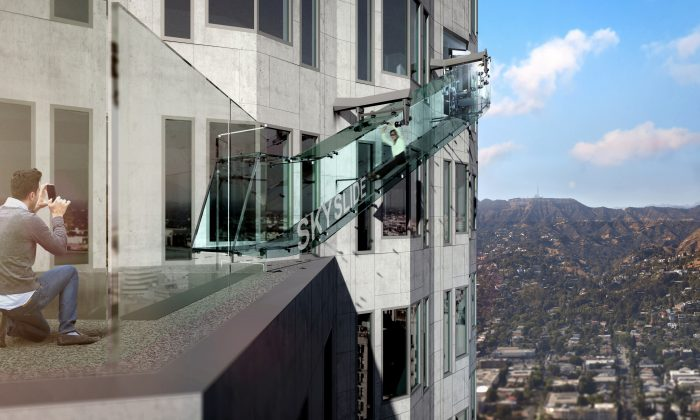 This undated artist's rendering provided by Overseas Union Enterprise Limited shows a glass slide 1,000 feet above the ground off the side of the U.S. Bank Tower in downtown Los Angeles. The 45-foot-long attraction is part of a $50 million renovation that will also put a bar and open-air observation deck on the top floors of the 72-story building. (Michael Ludvik/ OUE Ltd. via AP)