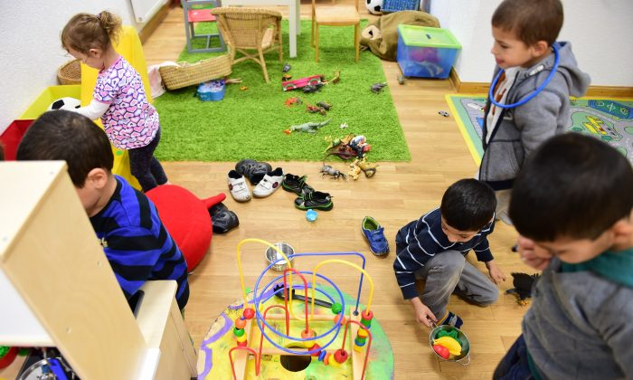Children play at a day-care centre in the Georg Kriedte Haus home for migrants in Berlin on October 8, 2015.  (JOHN MACDOUGALL/AFP/Getty Images)