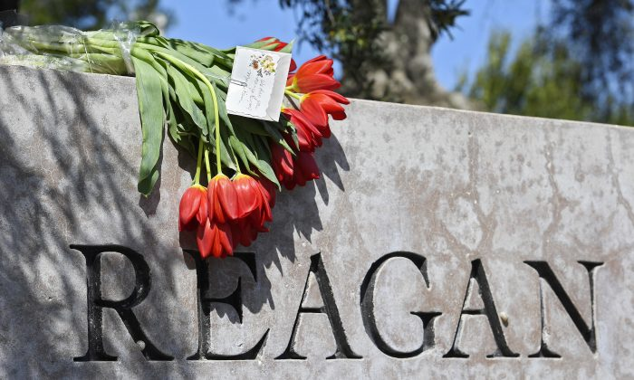 Flowers sit atop the sign at the entrance to the Ronald Reagan Presidential Library in Simi Valley, Calif., on March 6, 2016. (AP Photo/Mark J. Terrill)