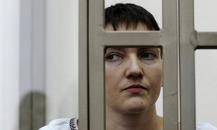 Ukrainian jailed military officer Nadezhda Savchenko stands in a glass cage during a trial in the town of Donetsk, Rostov-on-Don region, Russia, on March 3, 2016. Savchenko, a Ukrainian pilot on trial in Russia says she is going on hunger strike. Nadezhda Savchenko, on trial in the Russian border town of Donetsk for her alleged involvement in the deaths of two Russian journalists, was fighting in a volunteer battalion against Russia-backed separatists in eastern Ukraine when she was captured in June 2014. (AP Photo)