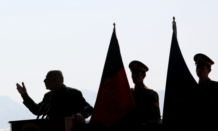 Afghan President Ashraf Ghani speaks during Afghan Air Force aerial demonstration ceremony in Kabul, Afghanistan, on Feb. 11, 2016. Afghanistan's air force has recently taken delivery of aircraft from the U.S. and India to enhance air power in the war against the Taliban, now in its 15th year. (AP Photo/Rahmat Gul)