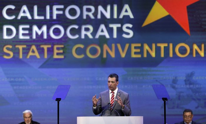 "In this Saturday, Feb. 27, 2016, photo California Secretary of State Alex Padilla gestures while speaking before the California Democrats State Convention in San Jose, Calif. ""There's no other fundamental right we have as citizens that requires you to register or fill out a form,"" said Padilla, who advocated for a California legislation for automatic registration bills. (AP Photo/Ben Margot)"