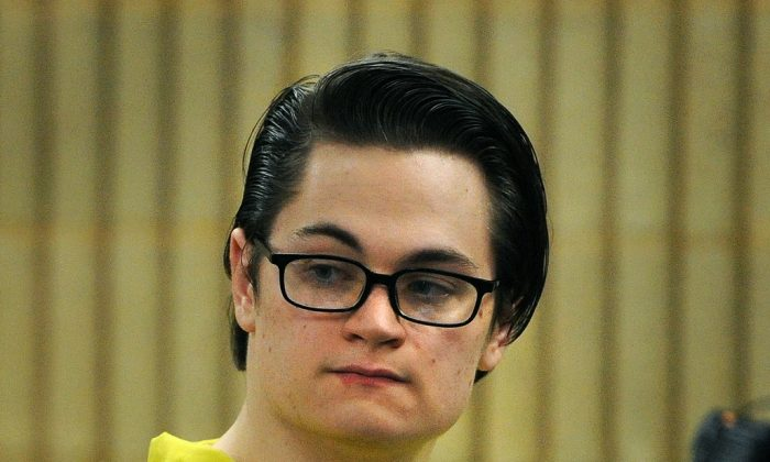 Christopher Plaskon appears in Superior Court in Milford, Conn., on Thursday, Jan. 28, 2016. Attorneys for the teenager charged with fatally stabbing a classmate on the day of their prom are continuing discussions with prosecutors on a potential plea agreement. (Brian A. Pounds /Hearst Connecticut Media via AP, Pool)