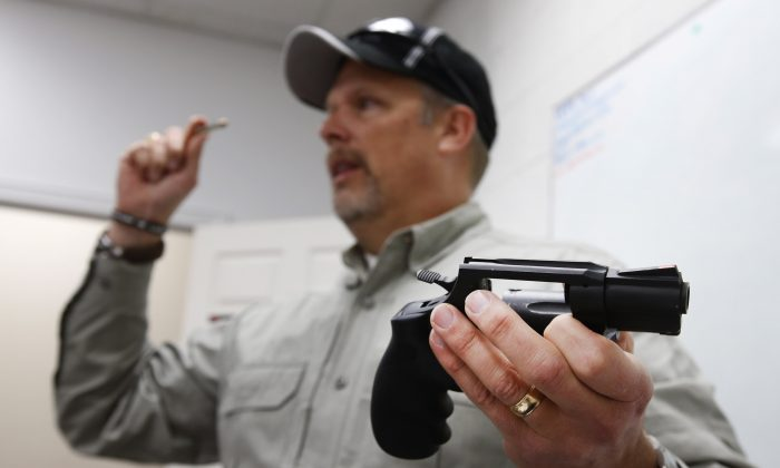 Gun instructor Mike Stilwell, demonstrates a revolver as as he teaches a packed class to obtain the Utah concealed gun carry permit, at Range Master of Utah, on January 9, 2016 in Springville, Utah. (George Frey/Getty Images)