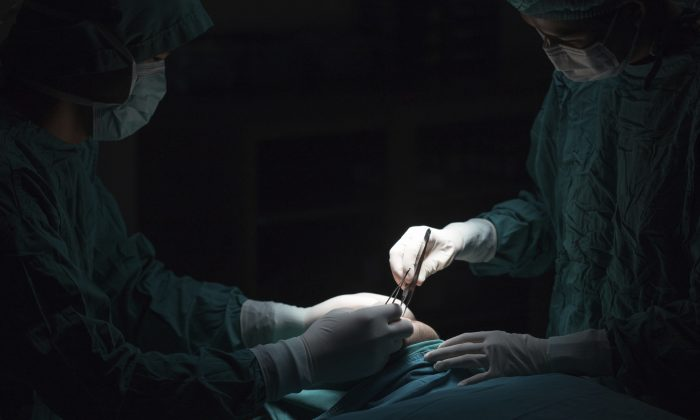 A stock photo of doctors doing surgery. (xmee/iStock)