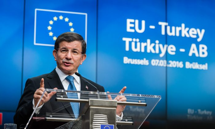 Turkish Prime Minister Ahmet Davutoglu speaks during a final media conference at an EU summit in Brussels on Tuesday, March 8, 2016. (AP Photo/Geert Vanden Wijngaert)