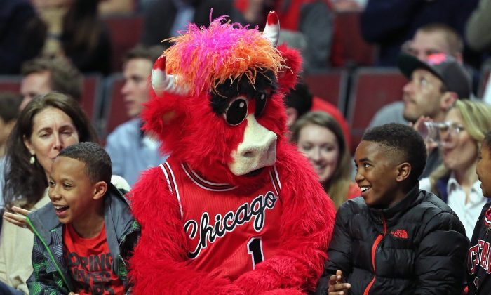 Benny, the mascot of the Chicago Bulls, entertains young fans siting courtside as the Bulls take on the Milwaukee Bucks at the United Center on March 7. (Jonathan Daniel/Getty Images)