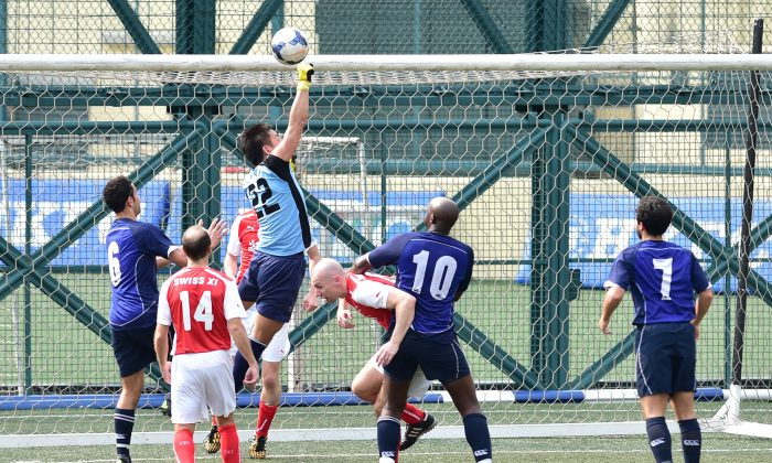 Swiss XI goalkeeper Yohei Zama punches clear during a Wanderers attack during the Yau Yee Division 1 match at Sports Road on Sunday March 6. Wanderers won the match 2-nil with both goals scored in the second half. (Bill Cox/Epoch Times)