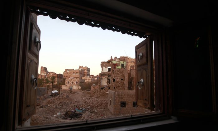 TOPSHOT - A picture taken on February 28, 2016 shows a window view of damaged houses following air strikes carried out by the Saudi-led coalition in the capital Sanaa. / AFP / MOHAMMED HUWAIS        (Photo credit should read MOHAMMED HUWAIS/AFP/Getty Images)
