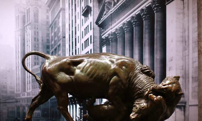 "A bronze statue of a bull fighting with a bear is displayed at the Museum of American Finance on Wall Steet in New York City on Oct. 7, 2008. An affiliate of the Smithsonian Institution and located in the former headquarters of the Bank of New York, the museum serves as a financial education center. Exhibitions include a history of U.S. currency, ticker tape from the ""Great Crash"" of Oct. 29, 1929, and a section of the 1858 Trans-Atlantic cable. (Spencer Platt/Getty Images)"