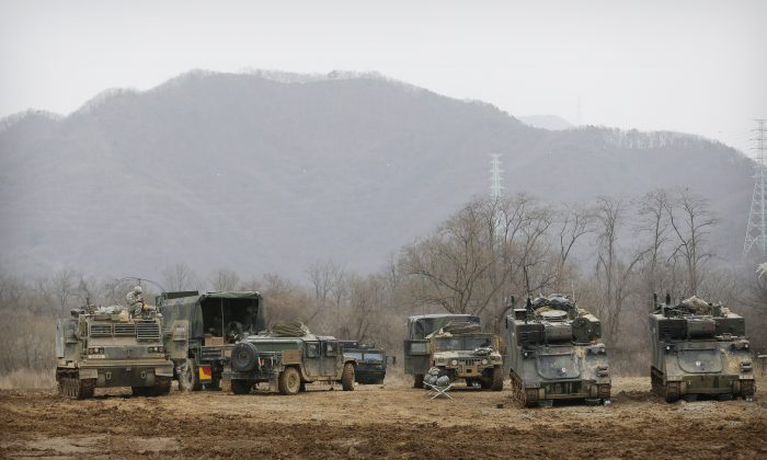 U.S. Army's armored vehicles take on a position during an annual exercise in Yeoncheon, near the border with North Korea, on March 7, 2016. (AP Photo/Ahn Young-joon, File)