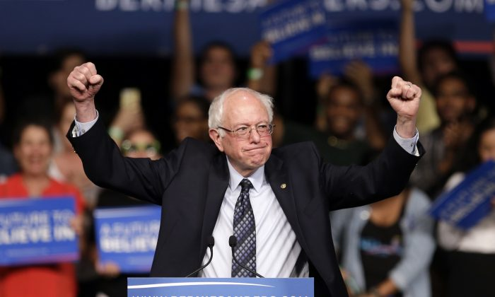 Democratic presidential candidate Sen. Bernie Sanders (I-Vt.) acknowledges his supporters on arrival at a campaign rally in Miami on March 8, 2016. (AP Photo/Alan Diaz)