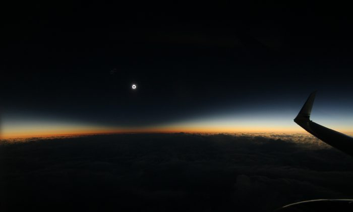The full shadow of the moon during the total solar eclipse on March 8, 2016, as seen from an airplane over the North Pacific Ocean. So-called eclipse chasers boarded a special flight from Anchorage to Honolulu to view the eclipse on Tuesday from the air. (Dan McGlaun/eclipse2017.org via AP)
