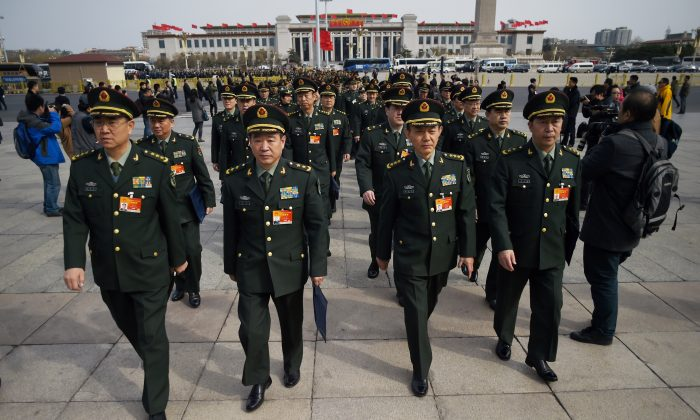 Military delegates arrive for the third session of the 12th National People's Congress outside the Great Hall of the People in Beijing on March 8, 2015. (Wang Zhao/AFP/Getty Images)