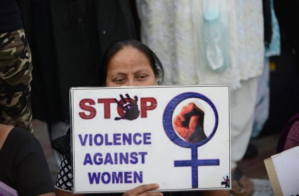 A woman attends a peace protest in Ahmedabad, India, on March 20, 2015, in the wake of the gang-rape on an elderly nun. (Sam Panthaky/AFP/Getty Images)