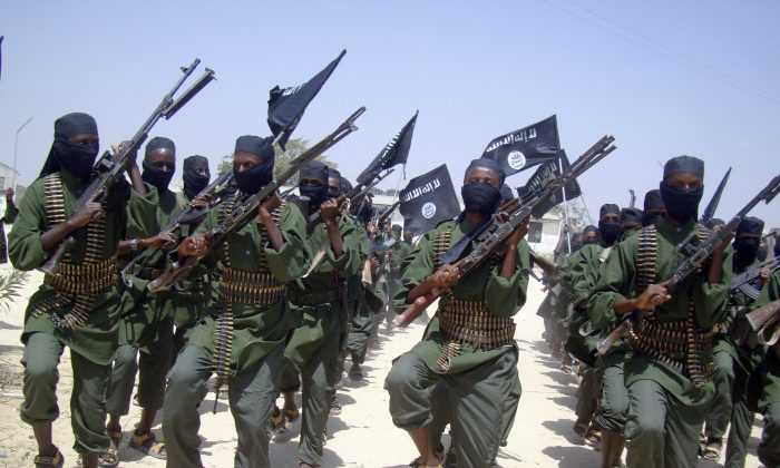 Al-Shabaab terroritst march with their weapons during military exercises on the outskirts of Mogadishu, Somalia, on Feb. 17, 2011.   (AP Photo/Mohamed Sheikh Nor)