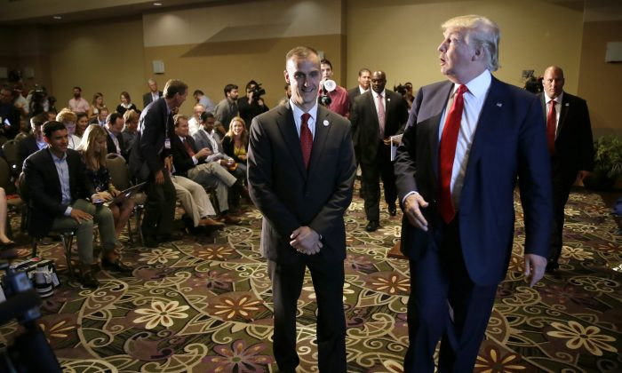 Republican presidential candidate Donald Trump walks with his campaign manager Corey Lewandowski, left, after speaking at a news conference, Tuesday, Aug. 25, 2015, in Dubuque, Iowa. (AP Photo/Charlie Neibergall)