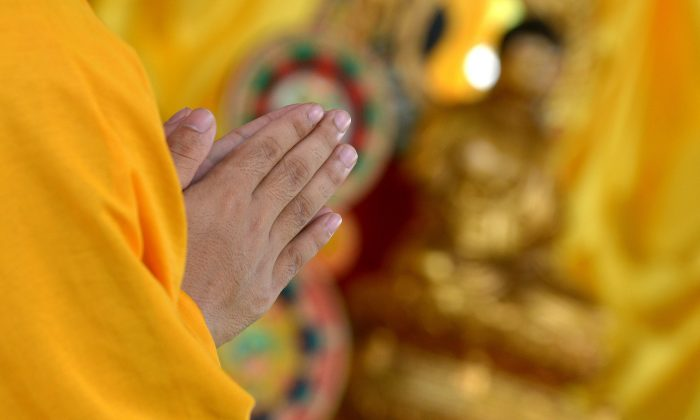 A Buddhist monk prays. (Jay Directo/AFP/Getty Images)