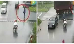 Watch Curious Chinese Woman Hit by Truck for Rubbernecking at Accident