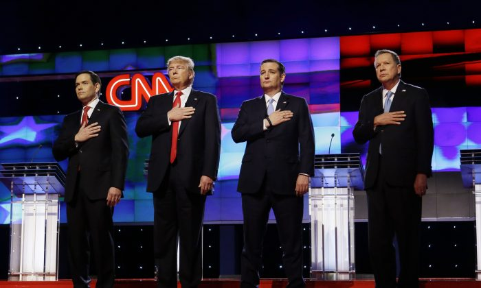 Republican presidential candidates, Sen. Marco Rubio, R-Fla., from (L), Donald Trump, Sen. Ted Cruz, R-Texas, and Ohio Gov. John Kasich, stand together during the signing of the National Anthem, before the start of the Republican presidential debate sponsored by CNN, Salem Media Group and the Washington Times at the University of Miami,  on March 10, 2016, in Coral Gables, Fla. (AP Photo/Wilfredo Lee)