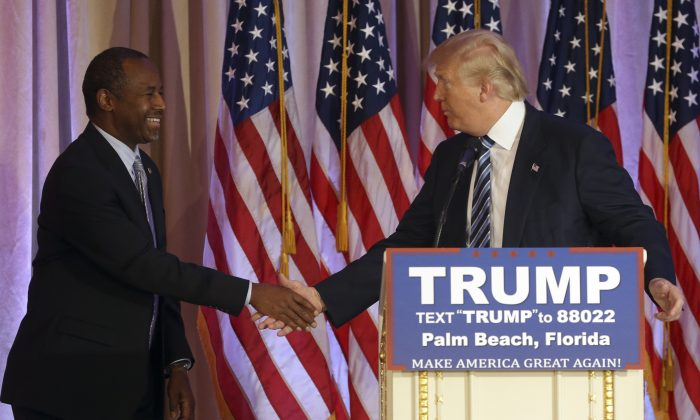 Former Republican presidential candidate Ben Carson shakes hands with Republican presidential candidate Donald Trump, after announcing he will endorse Trump during a news conference at the Mar-A-Lago Club, Friday, March 11, 2016, in Palm Beach, Fla. (AP Photo/Lynne Sladky)