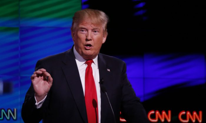 Republican presidential candidate, businessman Donald Trump speaks during the Republican presidential debate sponsored by CNN, Salem Media Group and the Washington Times at the University of Miami,  Thursday, March 10, 2016, in Coral Gables, Fla. (AP Photo/Wilfredo Lee)