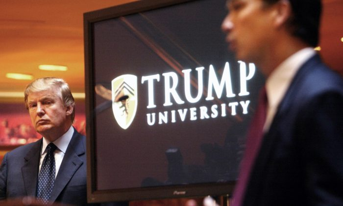 FILE- In this May 23, 2005, file photo, real estate mogul and Reality TV star Donald Trump, left, listens as Michael Sexton introduces him at a news conference in New York where he announced the establishment of Trump University. Tarla Makaeff a yoga instructor, has had enough of Trump after six years fighting him in court. Makaeff, wants to withdraw from a federal class-action lawsuit that claims Trump University fleeced students with an empty promise to teach them real estate. (AP Photo/Bebeto Matthews, File)