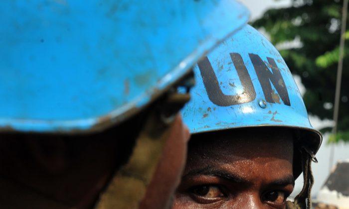 A U.N. peacekeeper looks on as he patrols in a street in Abidjan, Ivory Coast, on Jan. 8, 2011. (Issouf Sanogo/AFP/Getty Images)