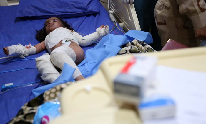 An Iraqi girl is treated at the general hospital in the northern Iraqi city of Kirkuk on March 10, 2016, after she was injured in a rocket attack in the nearby town of Taza. Seventeen residents of Taza were being treated following a rocket attack launched on March 9, 2016, from Bashir, south of the city of Kirkuk, medical sources said. Hundreds of protesters blocked Iraq's main highway on March 10, 2016, to demand strikes against Bashir from which the Islamic State (ISIS) launched a chemical attack. (Mohammed Sawaf/AFP/Getty Images)