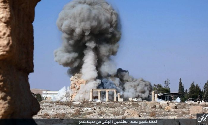 This undated photo, released Aug. 25, 2015, on a social media site used by ISIS militants, which has been verified and is consistent with other AP reporting, shows smoke from the detonation of the 2,000-year-old temple of Baalshamin in Syria's ancient caravan city of Palmyra. (Islamic State social media account via AP)