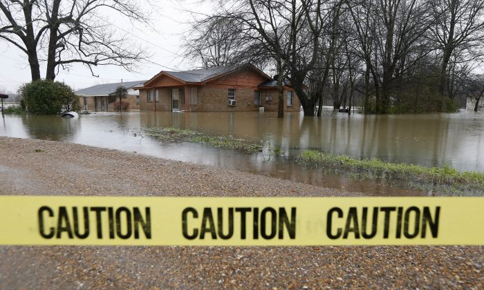 Caution tape closes off this neighborhood in Drew, Miss., on March 11, 2016, as floodwaters have affected areas in the Delta. The flooding has affected the Delta to varying degrees. Additional rain is expected to continue through Saturday. (AP Photo/Rogelio V. Solis)