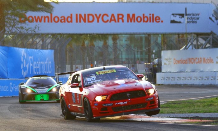 Jack Roush Jr. in the #60 Roush Performance Mustang hits the curb at Turn 11 at St. Petersburg on his way to winning his second Pirelli World Challenge GTS race. (Chris Jasurek/Epoch Times)