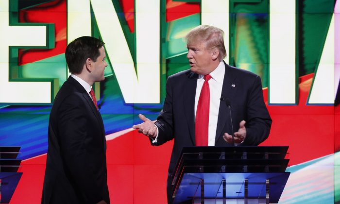 Republican presidential candidate, businessman Donald Trump, right and Republican presidential candidate, Sen. Marco Rubio, R-Fla., speak during a break in the Republican presidential debate Thursday, March 10, 2016, in Coral Gables, Fla. (AP Photo/Wilfredo Lee)