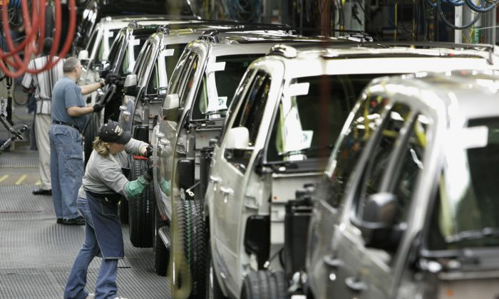 Workers assemble GM vehicles at the GM auto assembly plant in Arlington, Texas, on Feb. 9, 2009. Trying to make a stand in Michigan, Sen. Bernie Sanders said March 7, 2016, that Hillary Clinton was being disingenuous when she asserted that he opposed the auto bailout that rescued carmakers General Motors and Chrysler from oblivion during the economic crisis. (AP Photo/Tony Gutierrez)