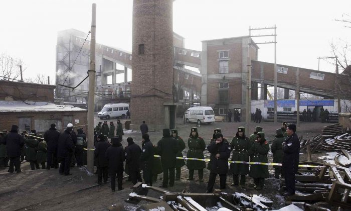 Police guard the Sunjiawan Coal Mine accident site on February 15, 2005 in Fuxin of Liaoning Province, northeast China. (China Photos/Getty Images)