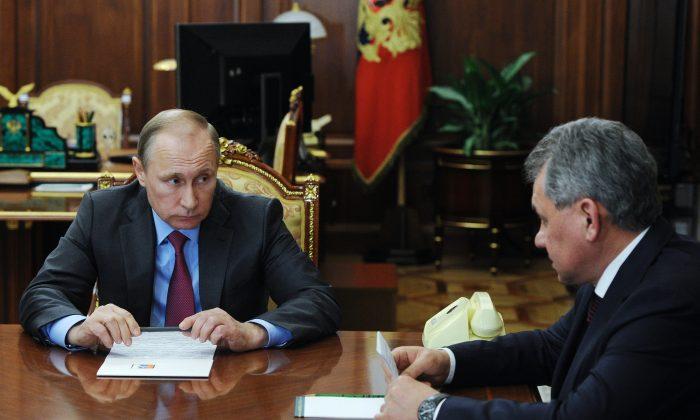 Russian President Vladimir Putin, left, listens to Russian Defense Minister Sergey Shoygu during their meeting in the Kremlin in Moscow on March 14, 2016. (Mikhail Klimentyev/Sputnik via AP)