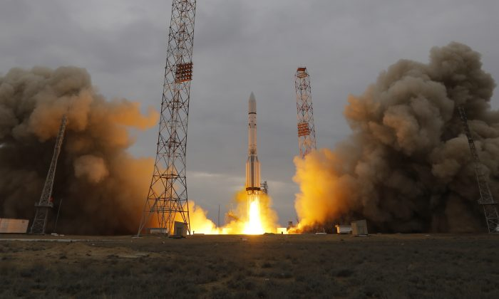 The Proton-M rocket booster blasts off at the Russian leased Baikonur cosmodrome, Kazakhstan, Monday, March 14, 2016. Europe and Russia launched a joint mission Monday to explore the atmosphere of Mars and hunt for signs of life on the red planet. The unmanned ExoMars probe, a collaboration between the European Space Agency and Roscosmos, took off aboard a Russian rocket and is expected to reach Mars in October. (AP Photo/Dmitri Lovetsky)